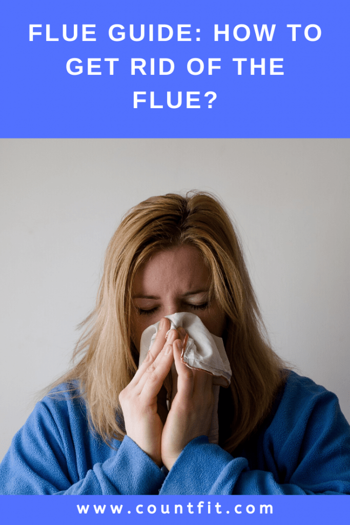 woman blowing nose flu